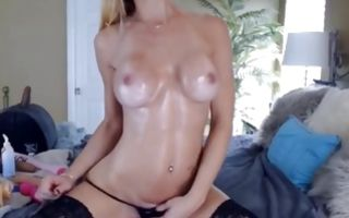 Fabulous Ex-GF with big oiled boobs playing with vagina