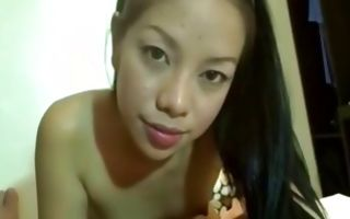 Sweet Asian girlfriend nicely sucking knob of horny dude