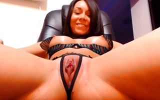 Sexy dark-haired girlfriend with hot body playing with muff